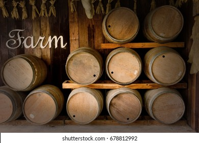 old wooden barrels stacked in winery