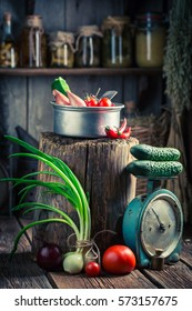 Old wooden basement with vegetables and preserves in jars