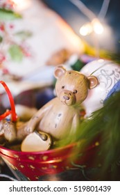 Old wooden bear toy in Christmas decorated room