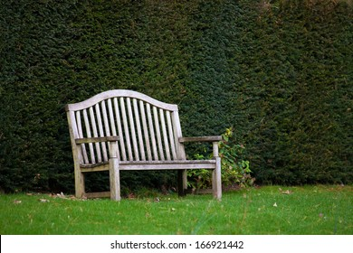 Old wooden bench in garden
