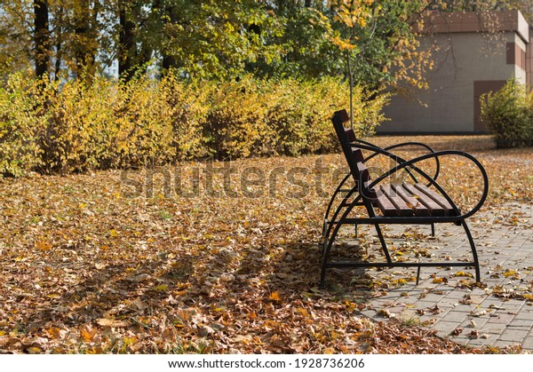 old-wooden-bench-iron-arms-600w-19287362