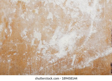 Old wooden board with flour. Background. Photo.