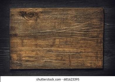 Old wooden board on a dark wooden background