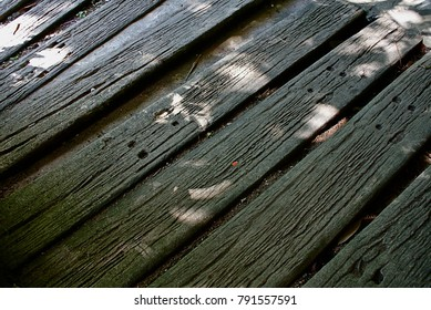 Old wooden board on the ground.