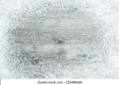 Old wooden board with snow flakes. Christmas background