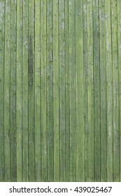Old wooden board. Wooden wall with a shabby old paint. Fence. Wood texture. Cross section of the tree.