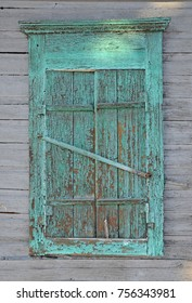 The old wooden boarded up window. Wooden shutters