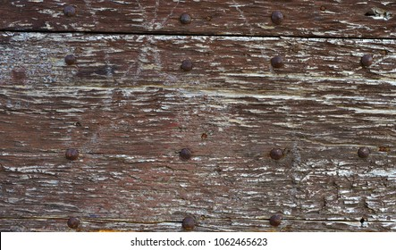 Old wooden boards with iron nails adn worn varnish background