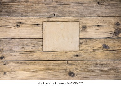 Old wooden boards, old paper with place for text. Vintage paper background.