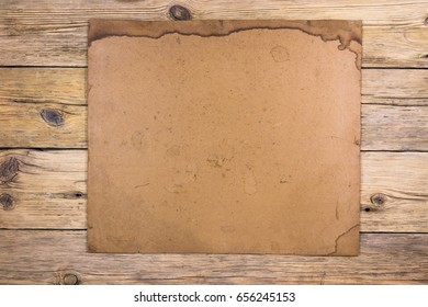 Old wooden boards, old paper with place for text. Vintage paper background. Passepartout