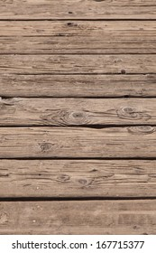 Old wooden boards from a pier to lake.