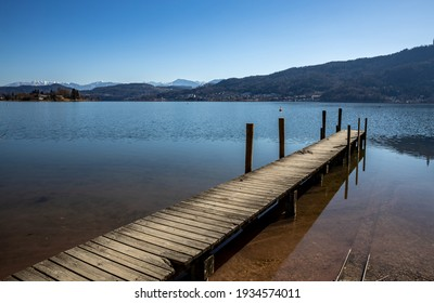 Old wooden boat dock on the Austrian lake Wörthersee in Carinthia in spring
