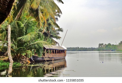 Old Wooden Boat on Edge of River in Jungle outside Kochi, India (Cochin / Kerala)