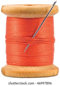 Old wooden bobbin with red thread isolated on white
