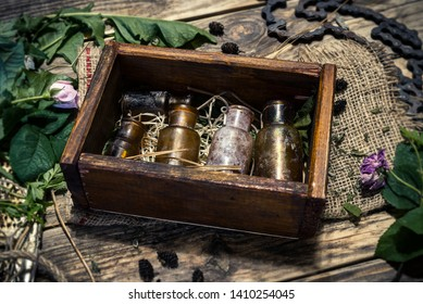 Old wooden box with vintage pharmacy glass bottles