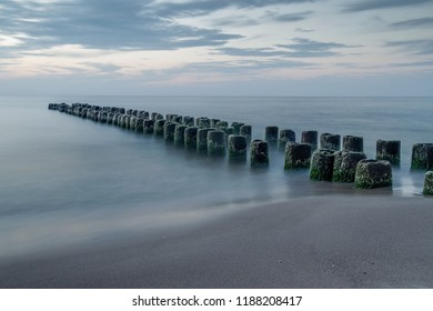 old wooden breakwater by the sea