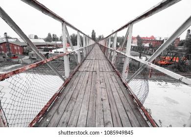 Old wooden bridge above abandoned train station