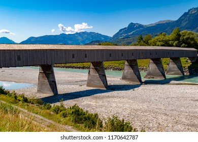The old wooden bridge across the river Rhine on the border of Liechtenstein and Switzerland