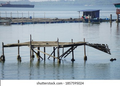 The old wooden bridge was broken in the middle of the sea.
