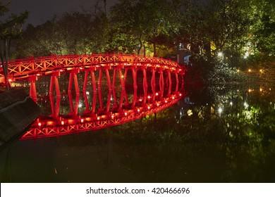 old wooden bridge at center of hanoi, night scene