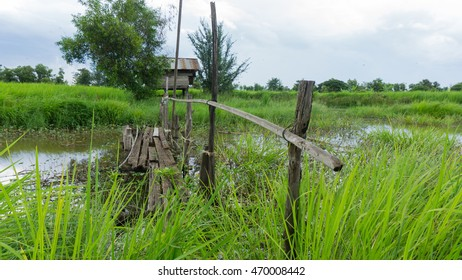 Old wooden bridge for crossing the canal