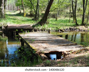 Old wooden bridge, a destroyed bridge over the river