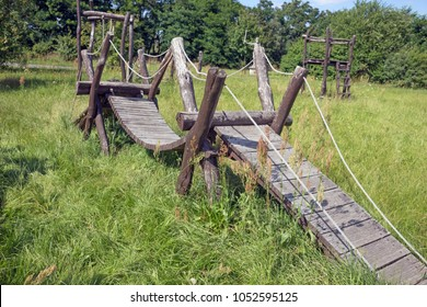 Old wooden bridge on a deserted children playground