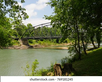 Old wooden bridge with steel railings at the War Eagle River in Rogers, Arkansas
