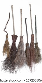 old wooden broomstick isolated on white background,Set of  different magical  brooms.