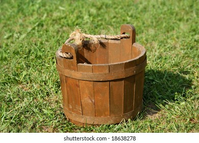 Old wooden bucket on grass