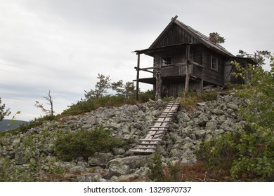 Old wooden cabin on the top of Levitunturi fell on autumn. This cottage is made of wood and it imitates the old way of building