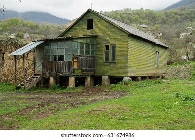 Old wooden cabin (painted green)