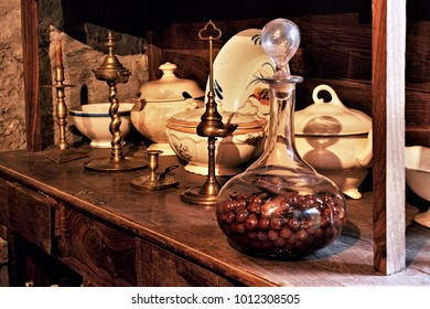 old wooden cabinet,old sideboard with crockery, tureens, dishes, fountains, and glass jar with cherry liqueur,in the kitchen of a rural house in Galicia, Galician ethnographic museum,