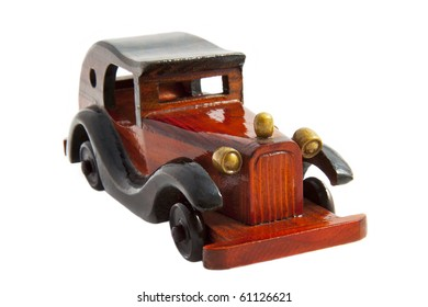 Old wooden car close up isolated over white