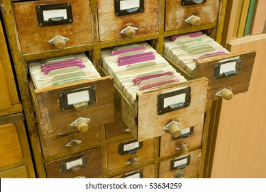 Old wooden card catalogs with open drawers