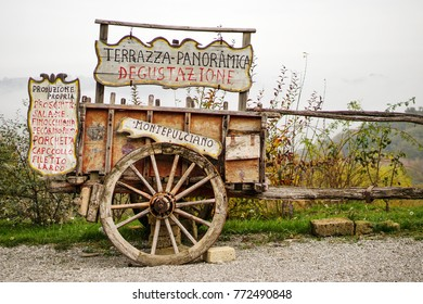Old wooden cart near a tasting typical products farmhouse in tuscan countryside of Montepulciano, Tuscany, Italy, Europe