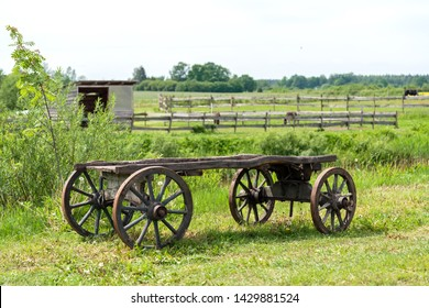 old wooden cart wagon green grass landscape
