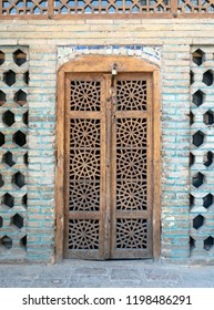 Old wooden carved door at Shah mosque, Isfahan, Iran