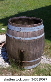 Old wooden cask on grass in yard