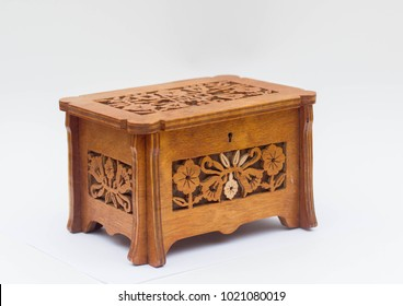 Old wooden casket with graved flower pattern isolated