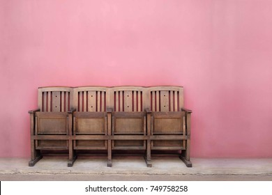 Old wooden chair with pink pastel color background