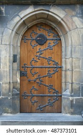 Old wooden church door with iron fittings