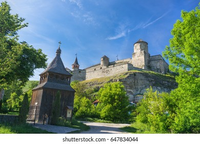 An old wooden church and the fortress of Kamyanets-Podilskiy, Ukraine