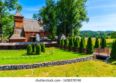Old wooden church listed on Unesco list in Debno village on sunny summer day