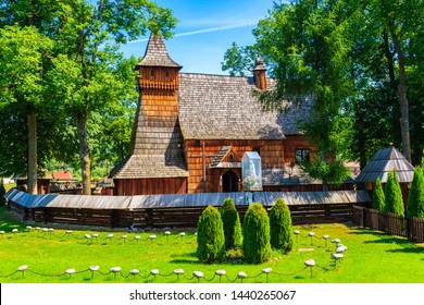 Old wooden church listed on Unesco list in Debno village on sunny summer day, Poland