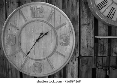 Old wooden clock on the old wooden wall.