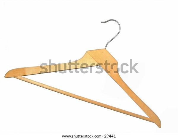 Old wooden coat hanger isolated on white.