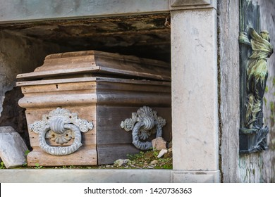 Old wooden coffin in decay at cemetery