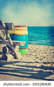 Old wooden colored barrel at the sea shore, vintage style