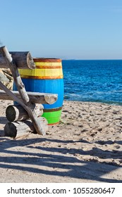 Old wooden colored barrel at the sea shore